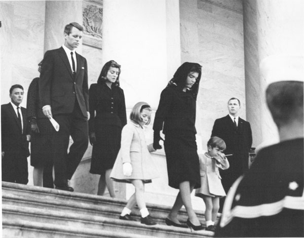 Mrs. Kennedy and the children leaving the White House for the funeral. Kennedy Library.