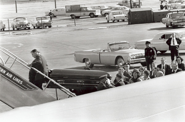 Loading Kennedy's casket onto Air Force One. Photo by Cecil Stoughton; Kennedy Library