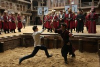 Ahmet and Iskender fighting with wooden swords